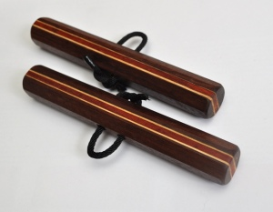 Octagonal Chizi Kunbo (pair) Katalox, Hickory, and Paduak 6 x 7/8 inches $45 (includes black cords)